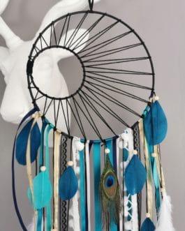 A Attrape rêves / dreamcatcher / attrapeur de rêves coloris bleu canard, turquoise et blanc avec tissage soleil