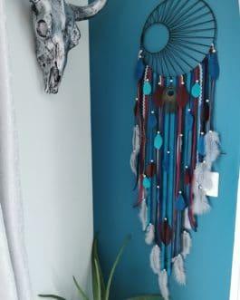 A Attrape rêves / dreamcatcher / attrapeur de rêves coloris bleu canard, bleu marine, bordeaux et gris avec tissage soleil